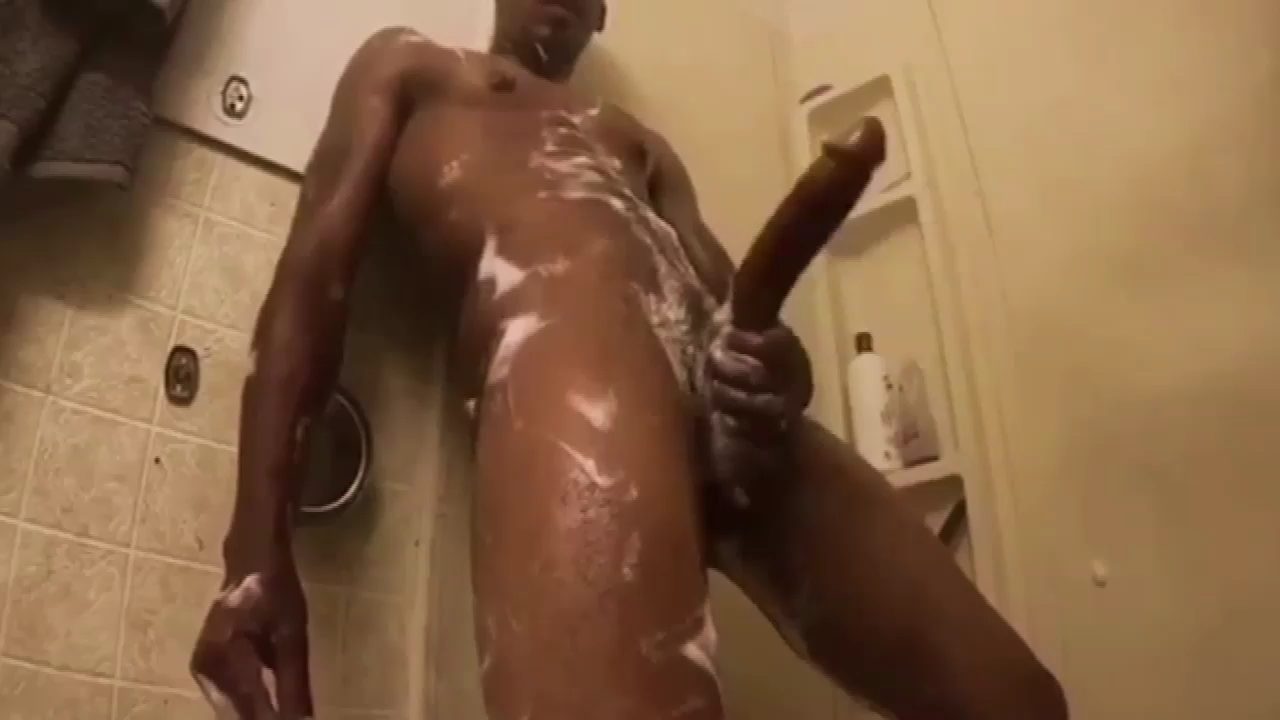 Horse hung black guy playing with his massive dick in the shower